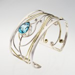 Silver Bracelet with heart shaped blue stone